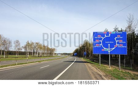 Roundabout road sign in Belarus.Translation to English:Babruysk roundabout sign