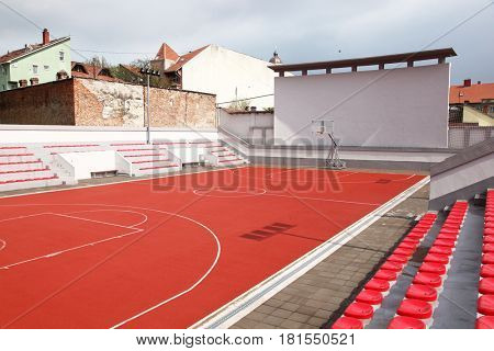 Basketball court outdoor with stands and seats