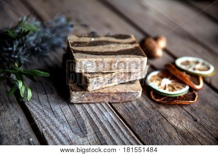Natural cosmetics. Organic scrub soap on wooden background. Purification, healthy skin and a beautiful body. Lavender and citrus. and