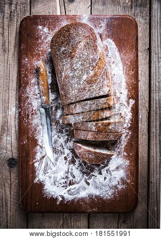 food. sliced rye bread on a wooden background. Bread flour and