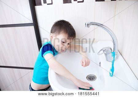 Boy cleaning in bathroom wash sink child doing up housework helping mother with sanitary cleanness of home traiding kid for housekeeping poster
