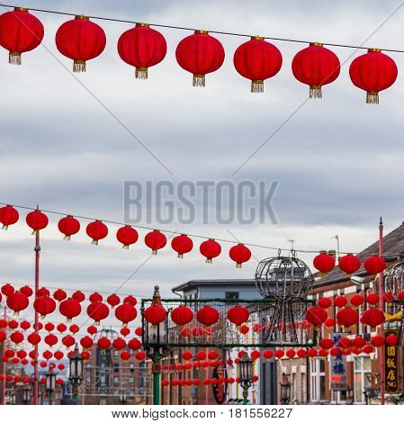 Vivid red coloured lanterns hung above Nelson Street in Liverpool to celebrate Chinese New Year.
