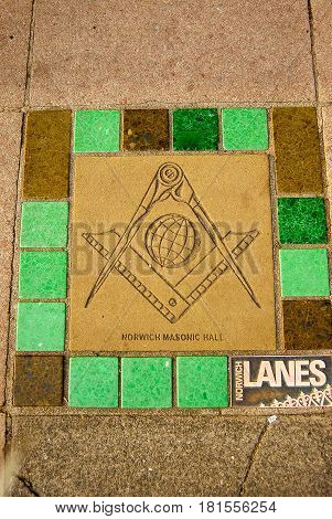 NorwichEngland-July 312016: The Masonic Square and Compass are embedded in the sidewalk at the entrance to the Norwich Masonic Hall in NorwichEngland