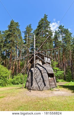 RIGA LATVIA - JUNE 13 2016: Dutch type windmill (erected in 1920s reconstructed in 1972) of Dervinieki village of Latgale ethnic group. Exhibited in Ethnographic Open-Air Museum of Latvia since 1973