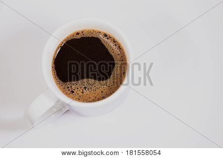 Cup of coffee on a white background top view.