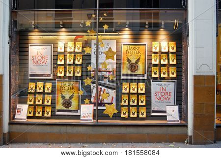 Norwich,England-August 3,2016: Bookstore windows displays the latest book by Authour J.K. Rowling