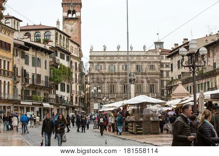 VERONA ITALY - MAY 1 2016: Tourists at the Piazza delle Erbe in the historic center of Verona Italy