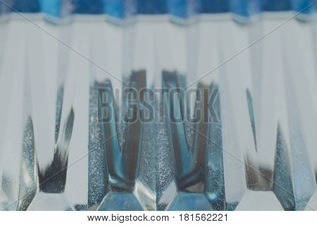 Abstract background of blue glass, macro photography of objects