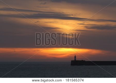 Sunset sky and clouds over Newhaven Lighthouse East Sussex.