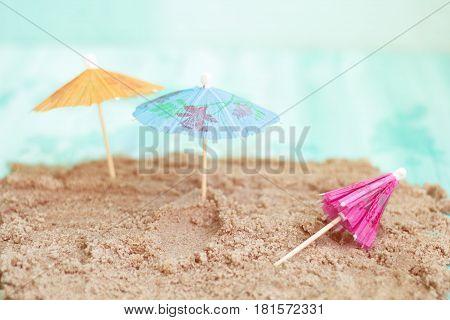 toy sun loungers on the sand beach