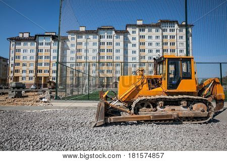 Yellow bulldozer working at the construction site