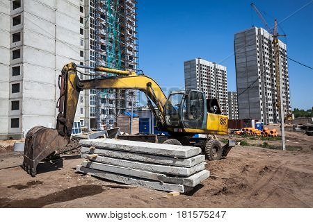 yellow excavator at sandpit during earthmoving works