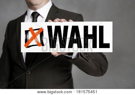 Wahl (in German Election) Sign Is Held By Businessman