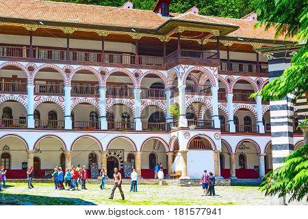 Rila, Bulgaria - June 25, 2015: People and beautiful buildings of famous Rila Monastery, Rilsky monastery or Monastery of Saint Ivan of Rila