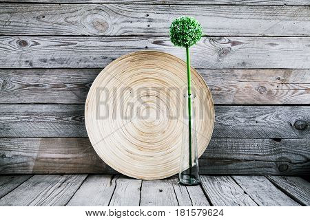 beautiful vase on abeautiful vase on a wooden plate with a flower on a wooden background wooden plate with a flower on a wooden background