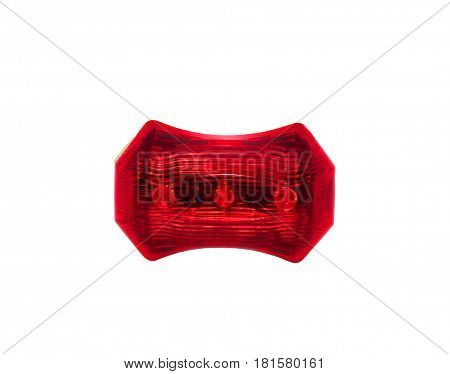 Red bicycle rear lamp on white background. Front view.
