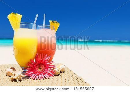Two Tropical Fresh Juices On White Sandy Beach