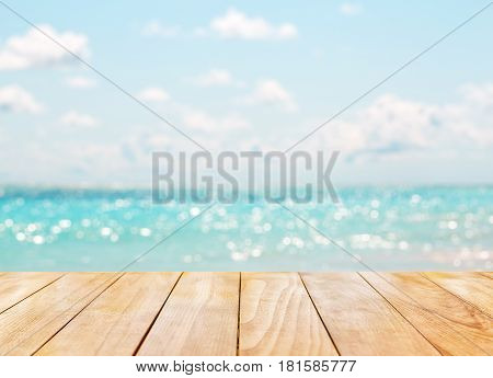 Wooden Table Top On Blue Sea