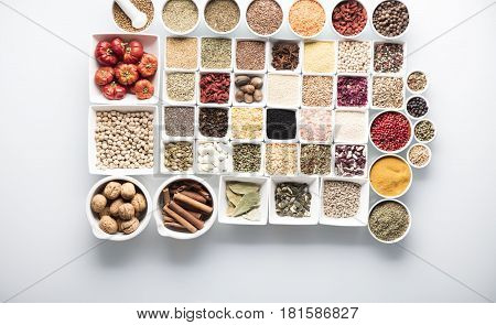 Spices and leguminous vegetables in bowls, isolated on white background