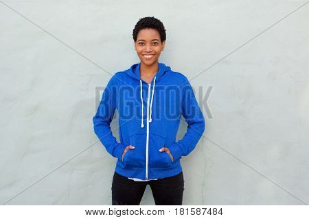 Attractive African American Woman Smiling With Blue Sweatshirt