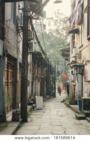 25Dec 2015ChinaChongqing : a traditional village and house Beside the famous travel attractions Ciqikou city of ancient and historical shophouseslocals walking throught old house