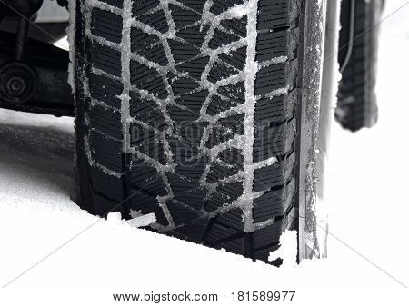 Mud all-terrain tire tread packed with snow stock photo