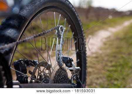 bicyclist repairs bicycle amongst hills