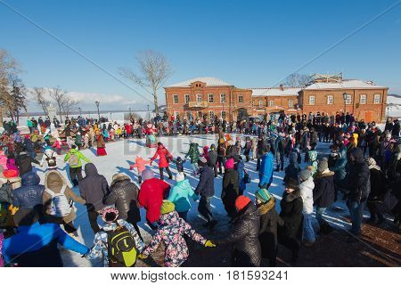 Sviyazhsk, Russia - 26 February 2017: The pancake week - Russian ethnic carnival, Maslenitsa Shrovetide the crowd dances before the burning of winter's effigies, wide angle