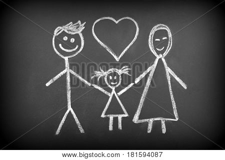 Drawing of muslim family with chalk on blackboard close up image