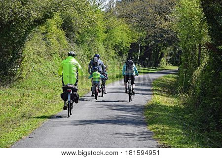Barnstaple Devon England UK - 11th April 2017. Enjoying a healthy day out by cycling on the Tarka Trail a traffic free 30 mile cycle way and footpath near Barnstaple in North Devon the route follows the rivers Torridge and Taw for much is its route.