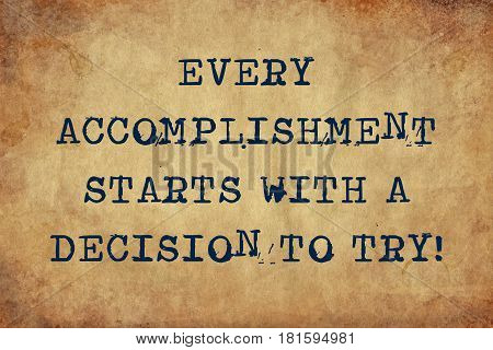 Inspiring motivation quote with typewriter text every accomplishment starts with a decision to try Distressed Old Paper with Typing image.