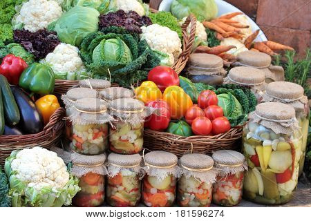 Fresh colorful vegetables and pickles in jars