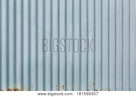 Background texture of rusty corrugated metal sheet