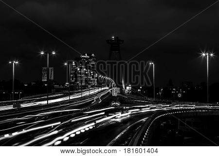 Nightfall on the UFO Bridge in Bratislava as cars travel home during rush hour.