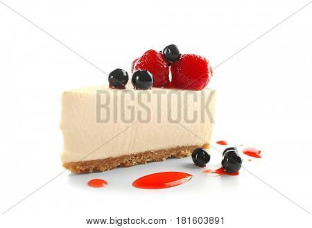 Delicious cheesecake slice with berries on white background