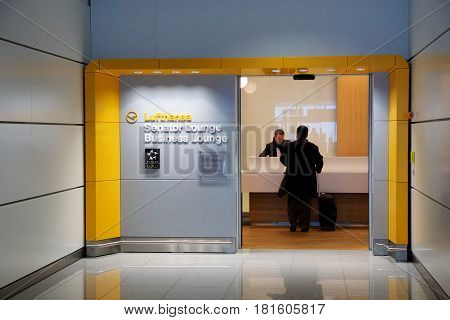 MUNICH, GERMANY - JAN 21st, 2017: airport interior, airport Lufthansa senator lounge entrance with business man checking in