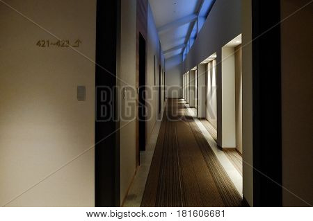 A Snug Corridor In The Hotel With Carpet