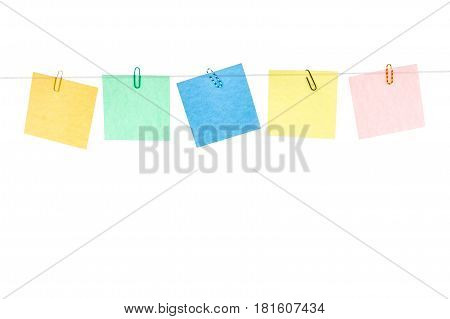 Colored yellow green blue red stickers with paper clips hanging on a rope Isolated on white background