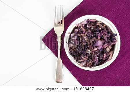 Braised red cabbage in white salad bowl. Studio Photo