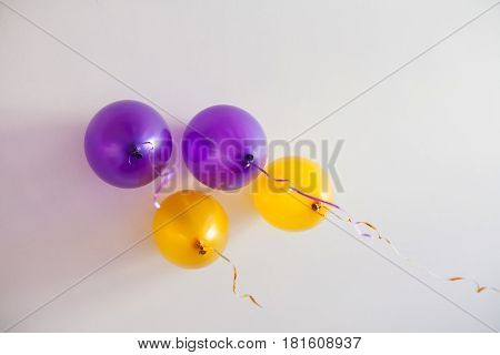 Balloons against the white ceiling. The balls are filled with helium. Soft focus.