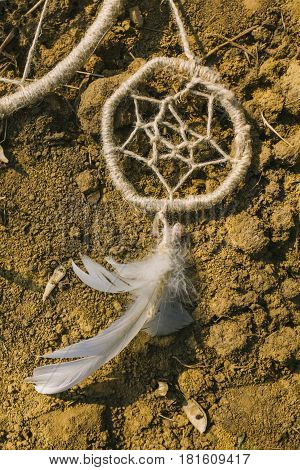 dreamcatcher lying on dry land. hipster style