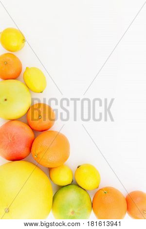 Food frame of lemon, orange, mandarin, grapefruit and sweetie on white background. Flat lay, top view.