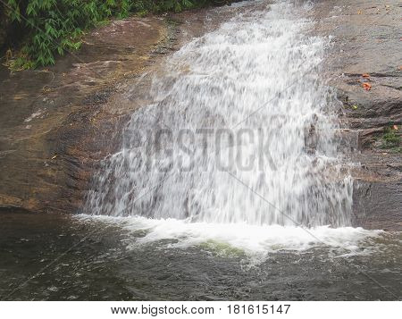 Waterfall on rocky terrain of brazil's natural reserve