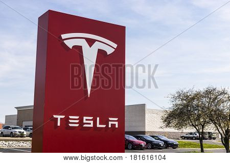 Indianapolis - Circa April 2017: Tesla Service Center. Tesla designs and manufactures the Model S electric sedan IV
