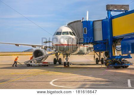 Passenger Jet Airplane At Airport Gate