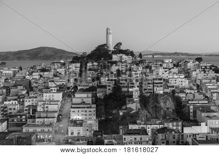 Black and white dusk view of Coit tower in downtown San Francisco, California.