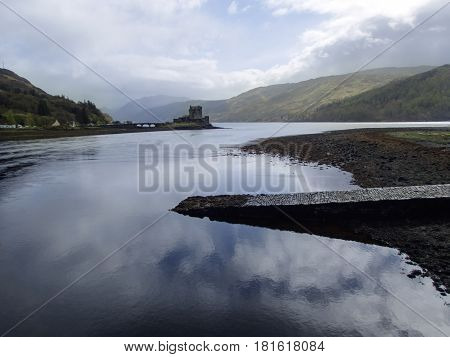 Beautiful Eilean Donan Castle and jetty with reflections on Loch Duich at Dornie Kyle of Lochalsh in the Scottish Highlands