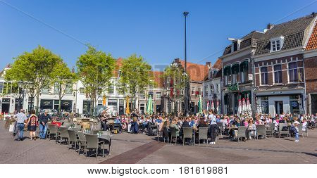 AMERSFOORT, NETHERLANDS - APRIL 09, 2017: People sitting and drinking outside on the central square of Amersfoort, Holland