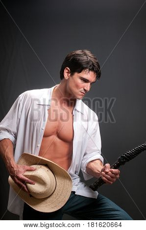 The hot guy is about to go to the rodeo.