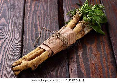 Raw Horseradish Roots On Wooden Background. Horseradish With Leaves.homemade Wassabi.closeup
